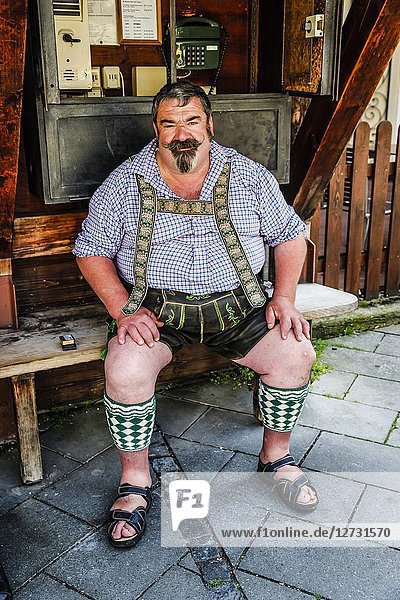 Stout Bavarian man in his Lederhosen in Garmisch-Patenkirchen  Bavaria  Germany.