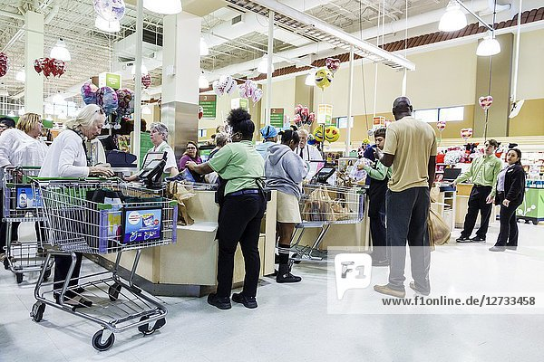 Florida  West Palm Beach  Publix Grocery Store supermarket  inside  checkout line queue  customers  cashier  bagger  employees