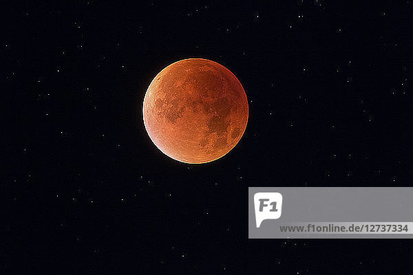 Total lunar eclipse with stars in background  blood moon