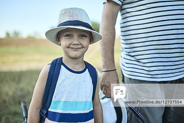 Portrait of smiling little boy wearing summer hat