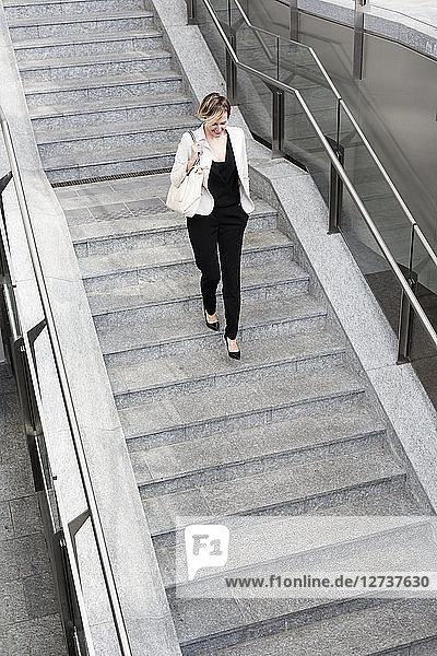 Businesswoman walking downstairs