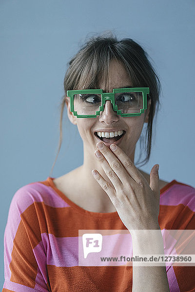 Young woman wearing pixel glasses  looking cross-eyed
