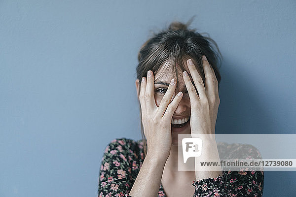 Beautiful woman covering face  portrait