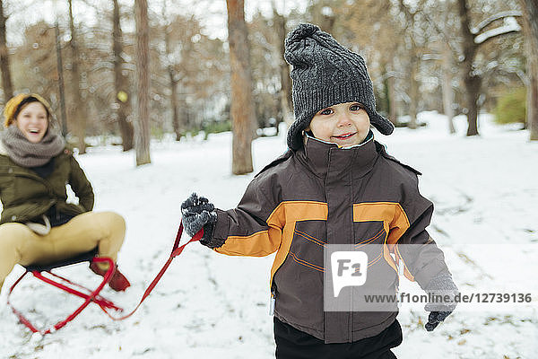 Portrait of little boy in the snow