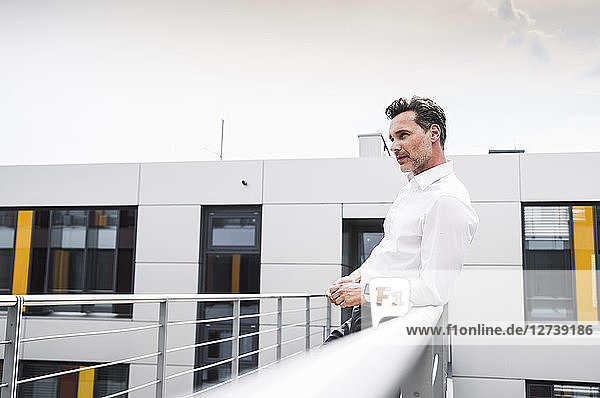 Businessman on skywalk at office building