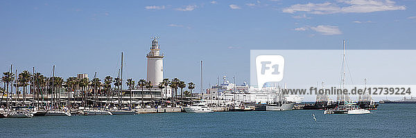 Spain  Andalusia  Malaga  Panoramic view of harbour  lighthouse La Farola de Malaga