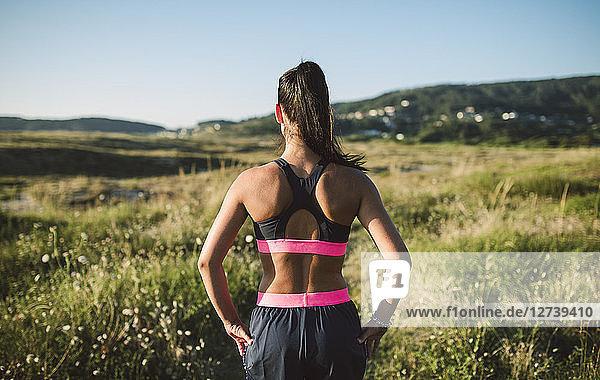 Portrait of a female jogger  rear view