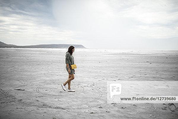 South Africa  Western Cape  Noordhoek  woman walking on the beach