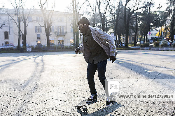 Young man skateboarding on an urban squarre