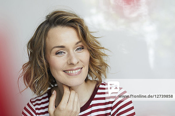 Portrait of smiling woman wearing red-white striped t-shirt