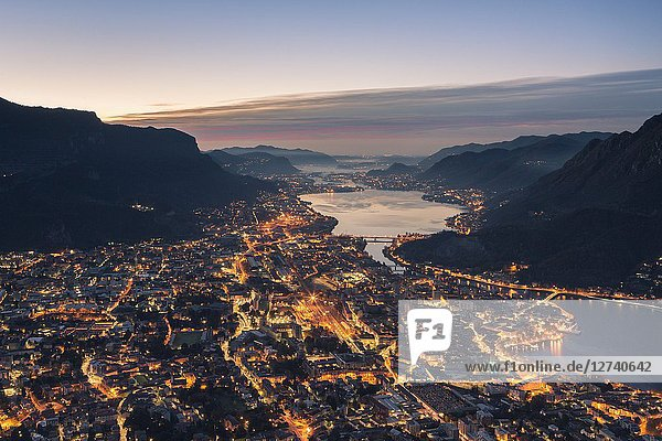 Overview of Lecco before dawn from San Martino Lecco  Lecco province  Lombardy  Italy.