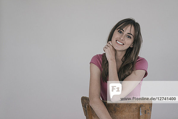 Portrait of a smiling woman  sitting on a chair