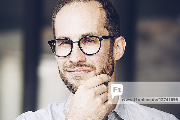 Portrait of sceptical businessman wearing glasses