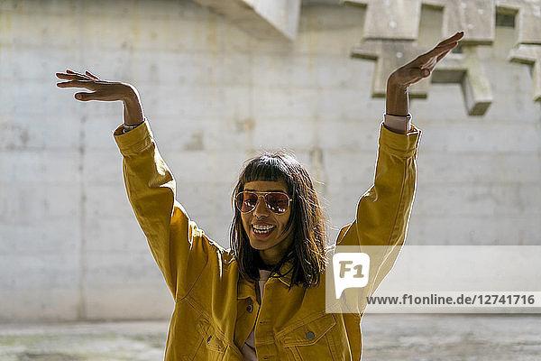 Young woman singing  raising arms