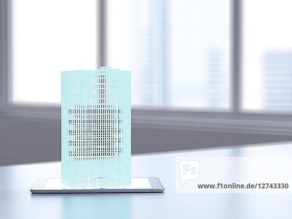 3D rendering  Hologram of building on digital tablet on desk