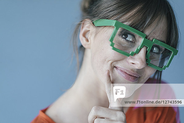 Young woman wearing pixel glasses  smiling