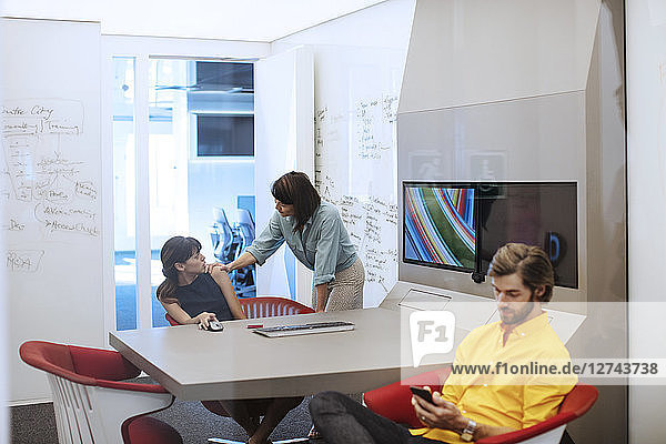 Business people in futuristic office having a meeting