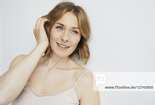 Portrait of smiling woman wearing top