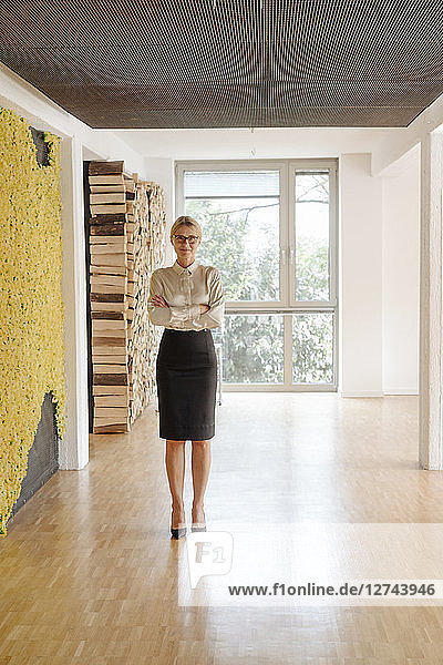 Confident businesswoman standing on office floor