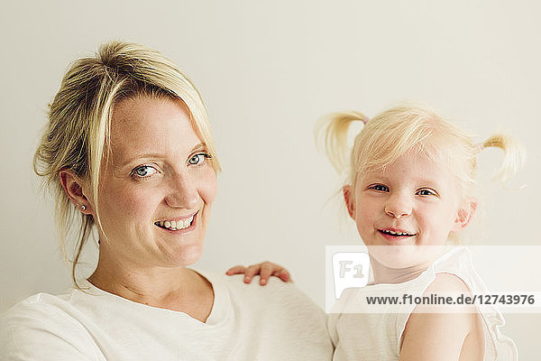 Portrait of smiling mother her little daughter