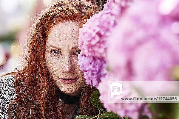 Portrait of redheaded young woman with freckles