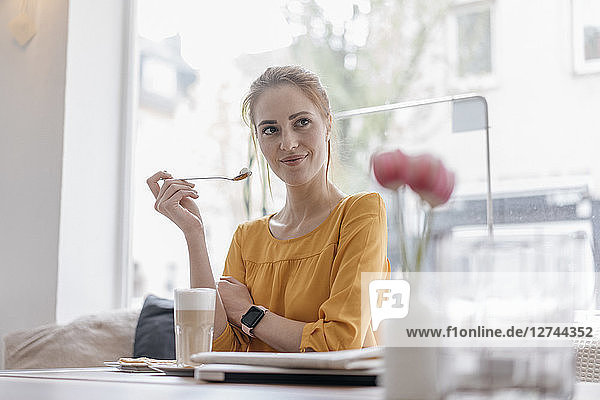 Young woman working in coworking space  taking a break