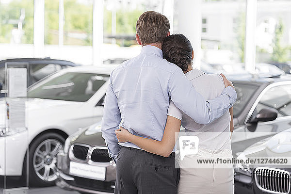 At the car dealer  Couple in showroom