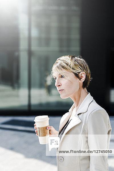 Portrait of businesswoman with Coffee to go