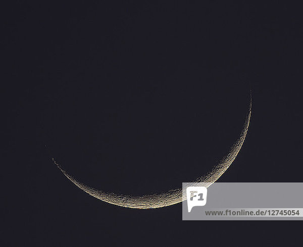 Germany  Hesse  Hochtaunuskreis  new moon crescent with craters