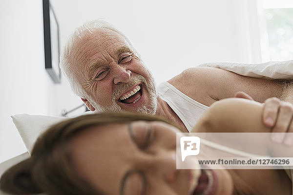 Playful  affectionate senior couple in bed