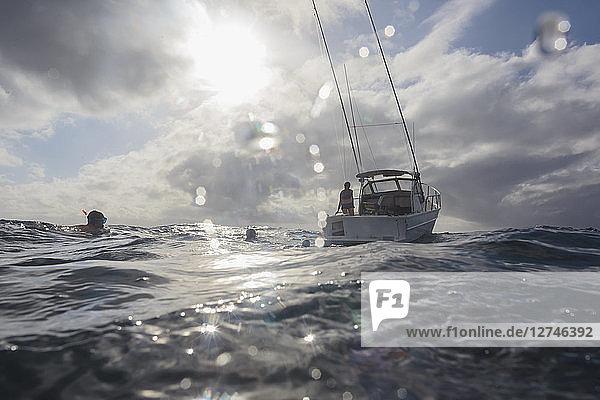 Man snorkeling in sunny ocean near boat  Vava'u  Tonga  Pacific Ocean
