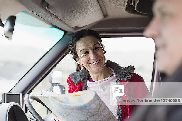 Couple with map  in motor home