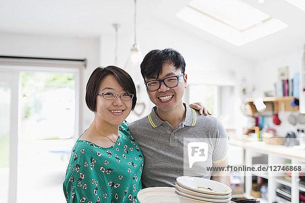 Portrait happy couple in kitchen