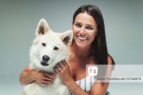 Portrait smiling woman with dog