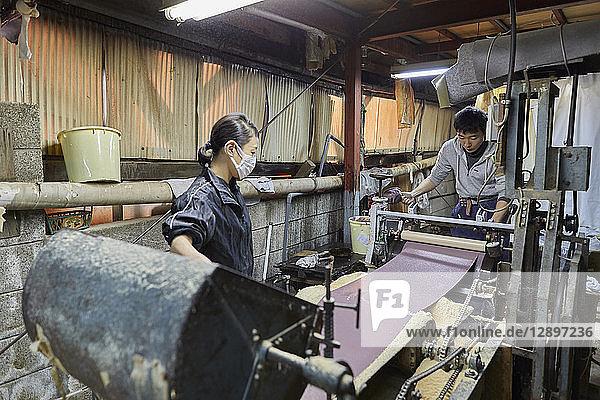 Japanese artisans working in the studio