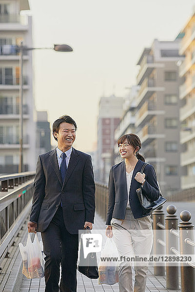 Japanese couple commuting home from work
