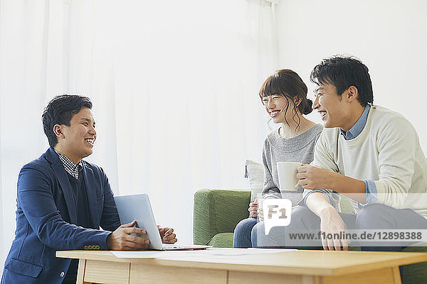 Japanese couple talking with consultant