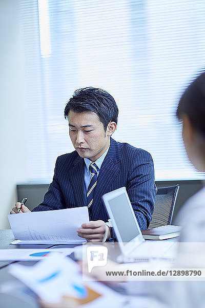 Japanese businesspeople in a meeting