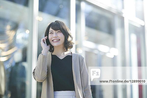 Japanese woman window shopping downtown Tokyo