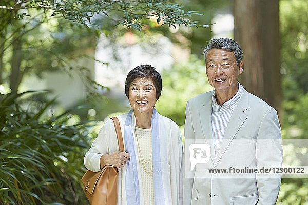 Japanese senior couple having fun at traditional inn
