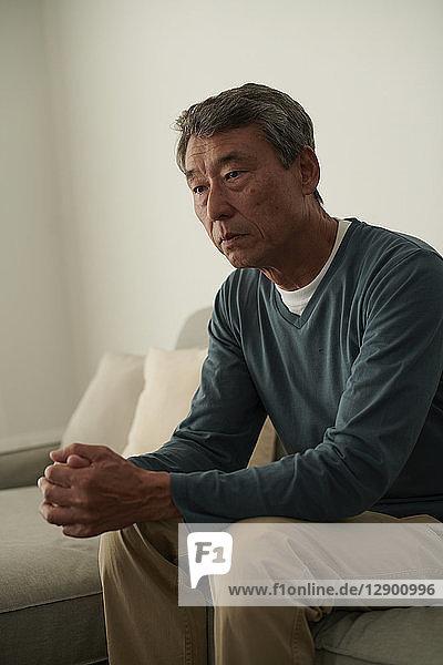 Japanese senior man on the sofa