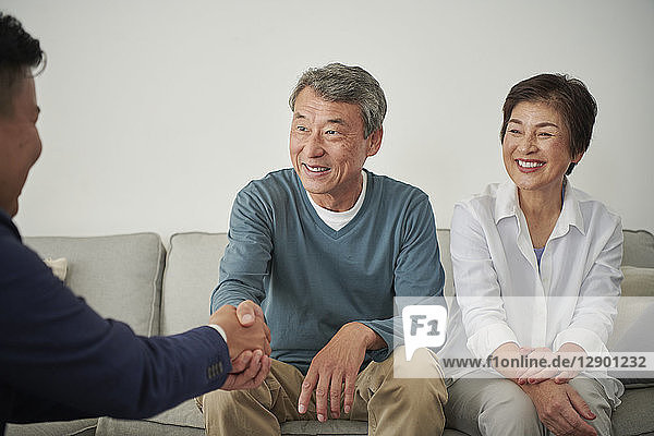 Japanese senior couple talking with consultant