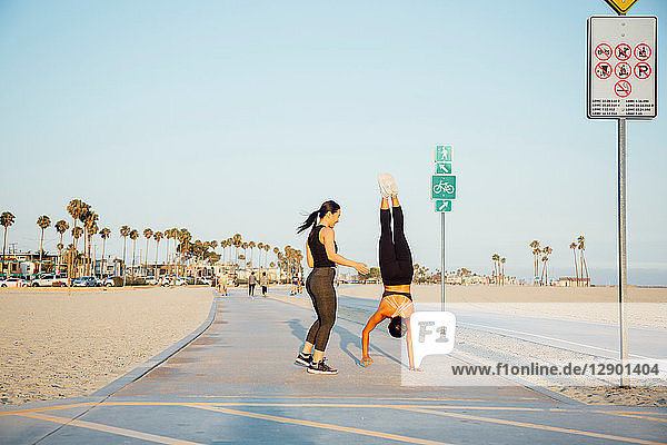 Friends doing exercises by beach  Long Beach  California  US