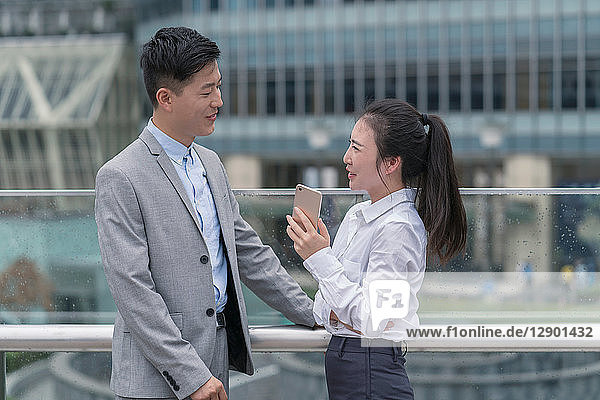 Young businesswoman and man talking in city  Shanghai  China