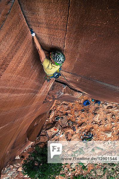 Man trad climbing  Indian Creek  Moab  Utah  USA
