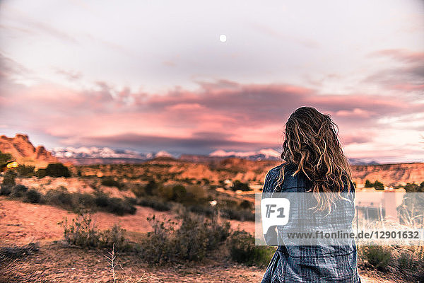 Woman looking at sunset in the desert,  Moab,  Utah