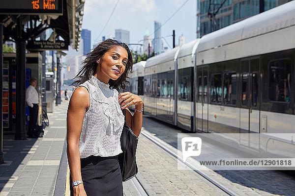 Businesswoman on train station platform