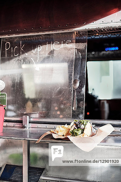 Food served through window of food truck