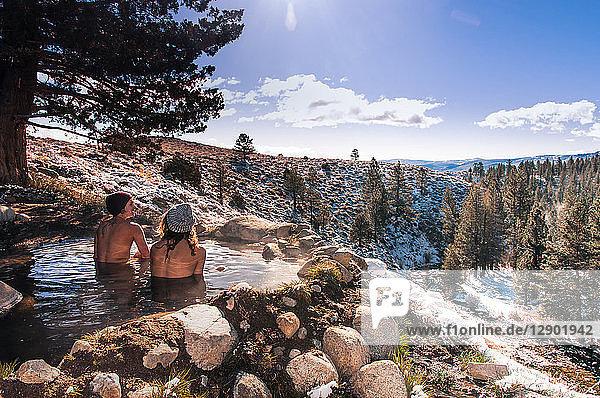 Tourists relaxing in hot spring near Bridgeport  California  USA