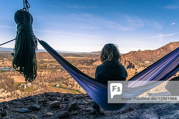 Rock climber on hammock on summit  Smith Rock State Park  Oregon  USA